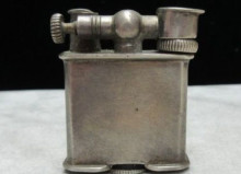 antique silver cigarette lighter